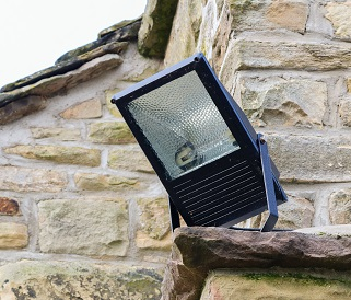 Home Security Light Mounted On The Corner Of A Rural Stone Cotta