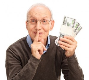 Senior gentleman holding three stacks of money and holding a fin